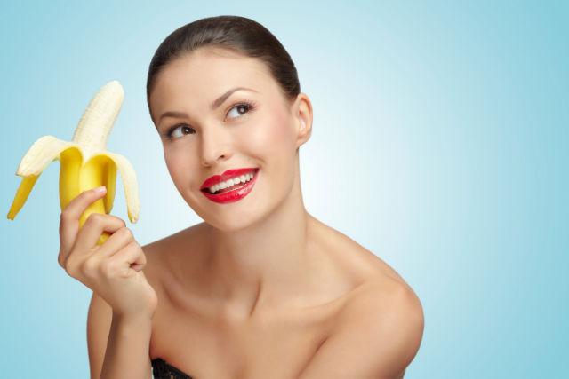 Peeling off banana.