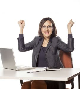 happy young businesswoman with the winning gesture