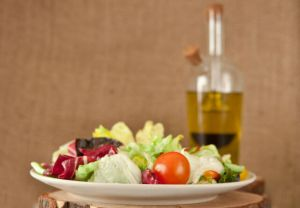 Fresh salad and olive oil