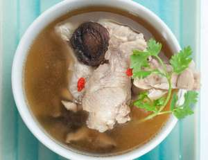 Traditional oriental chicken broth with mushrooms