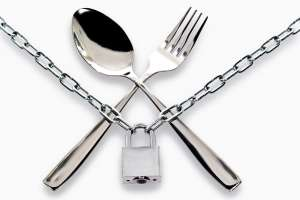 """Fork and spoon armored chain and padlock"""