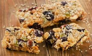 Healthy fruit and nut granola bars on a wooden table.