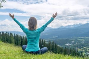 Woman Meditate at the Mountains