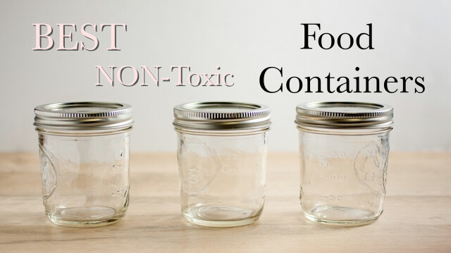 Empty canning jars on a wooden tabletop.
