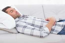 A man lying on the sofa