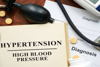 High blood pressure   hypertension  written on a book. Medical concept.
