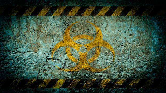 Nuclear radiation warning symbol on grunge wall background