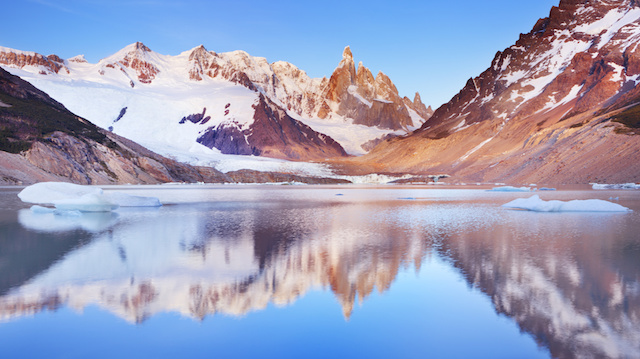 Cerro Torre, Patagonia, Argentina reflected in lake below, at sunrise