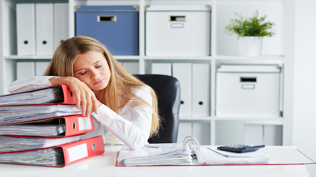 Tired woman sleeping in the office