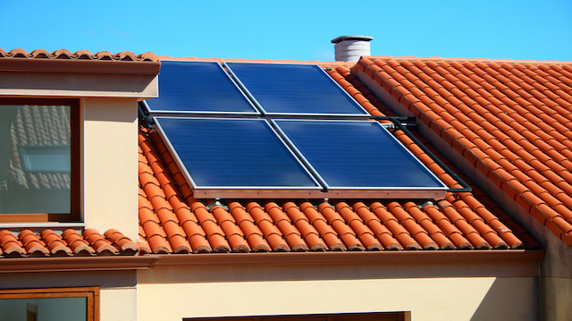 Solar panels over a home roof