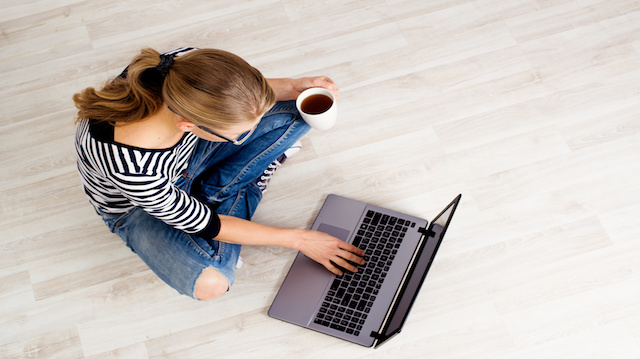 Ecommerce woman. Young female using computer for online shopping