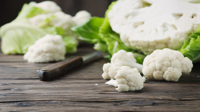 Fresh raw cauliflower on the wooden table