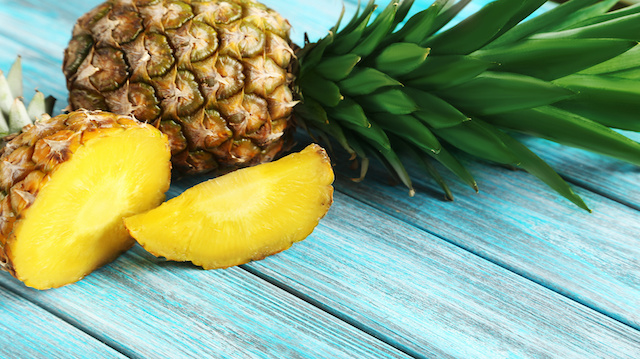 Ripe pineapples on a blue wooden background