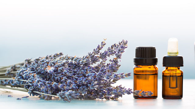 Essential oils in bottles with lavender