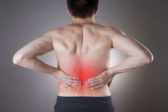 Kidney pain. Man with backache. Pain in the man's body