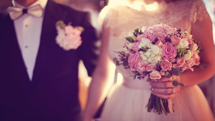 Bride holding her wedding bouquet in the church