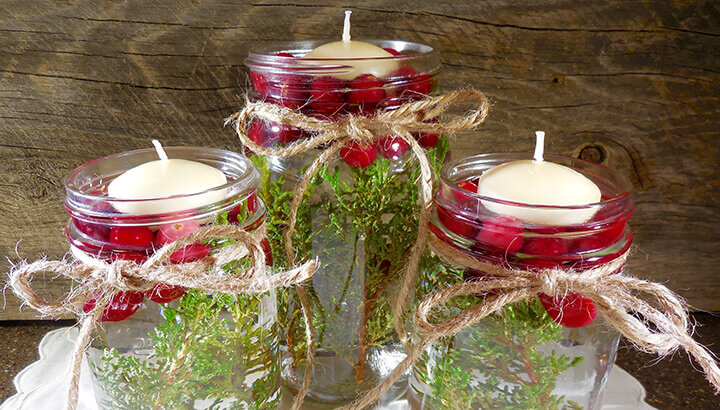 Christmas Floating Candles With Cranberries And Greenery