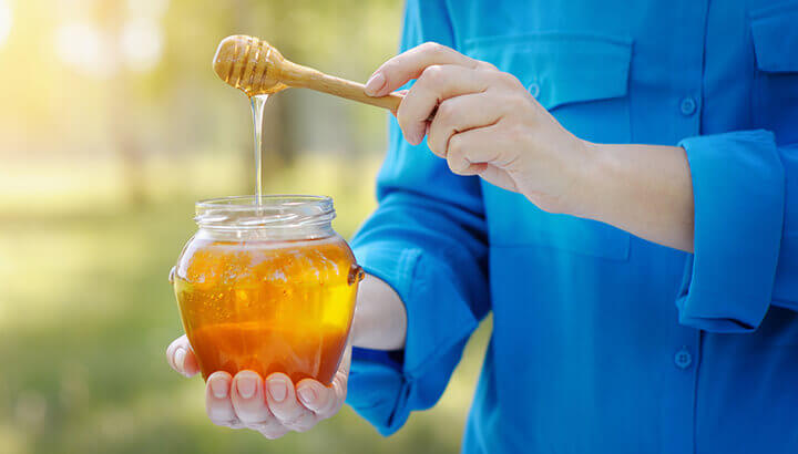 Add honey to coffee