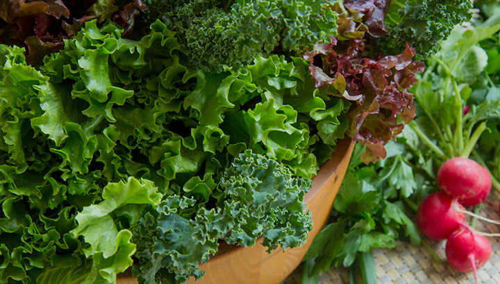 Getting plenty of iron in leafy greens can help prevent hair loss.
