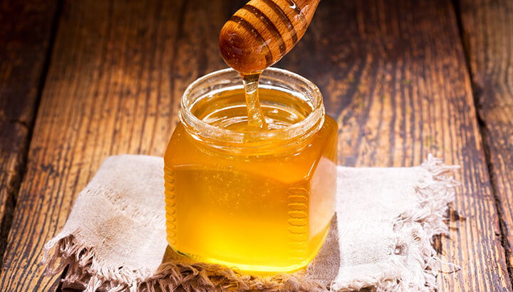 Adding raw honey to water can help you fight infections, boost immunity and more.