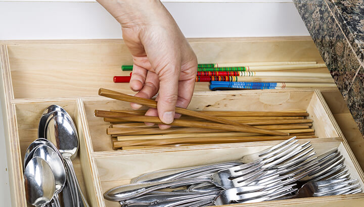 Declutter your kitchen by going one through one drawer at a time.