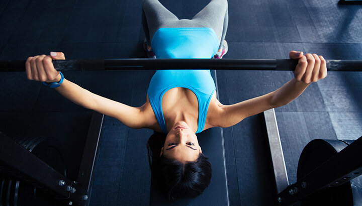 Exercises like the chest press can help keep your breasts perky