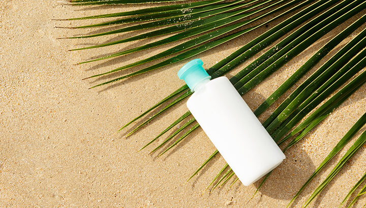 Use an empty sunscreen bottle to keep your valuables safe