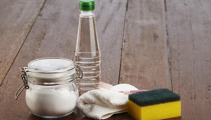 White vinegar and baking soda will keep your pans clean.