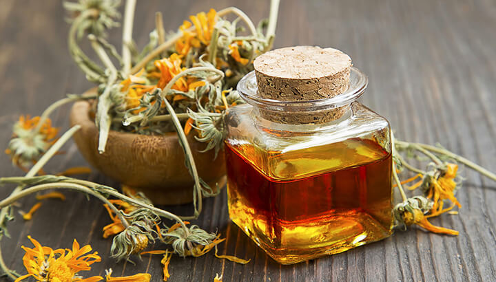 Coconut oil infused with herbs and flowers can reduce ear pain naturally.