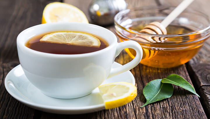 If you feel under the weather from swine flu, drink tea with lemon and honey.
