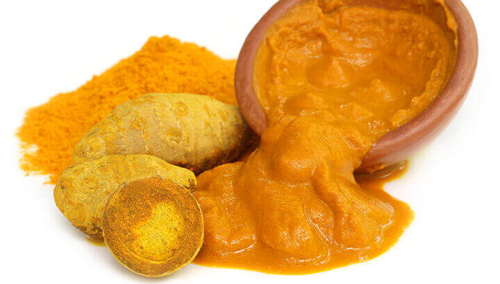 Make turmeric paste by mixing turmeric, water and pepper.