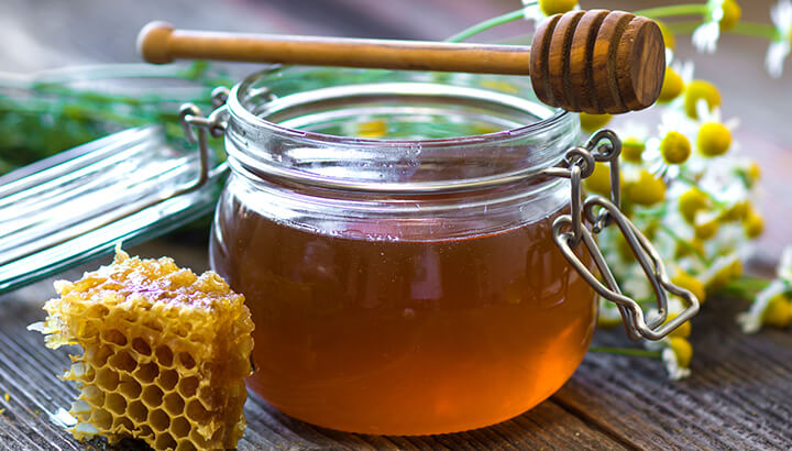 Raw honey in coffee adds a sweet flavor and provides health benefits.